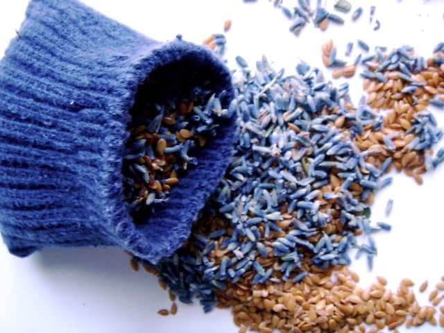 open blue sock filled flax seed lavender over flaxseed lavender pile