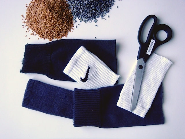 Flax seeds Lavender and cut up socks next to scissors
