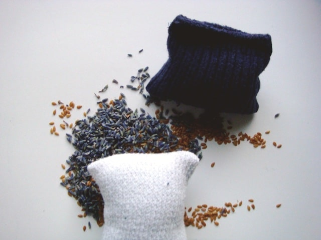 white sock blue sock filled flaxseed lavender dryer balls over flaxseed lavender pile