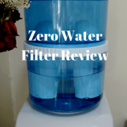 Large blue plastic water containers on top of white water cooler