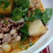 white bean ground turkey potato chili scallion cilantro garnish in white bowl