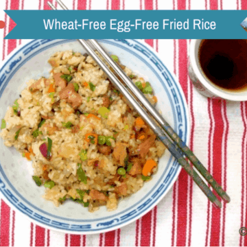 Ham and various vegetable egg free fried rice wheat free soy sauce in blue white bowl