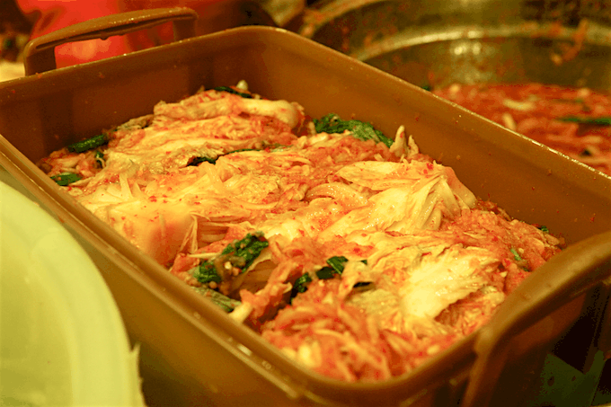 Kimchi packed plastic containers