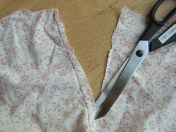 cutting old sheets with scissors