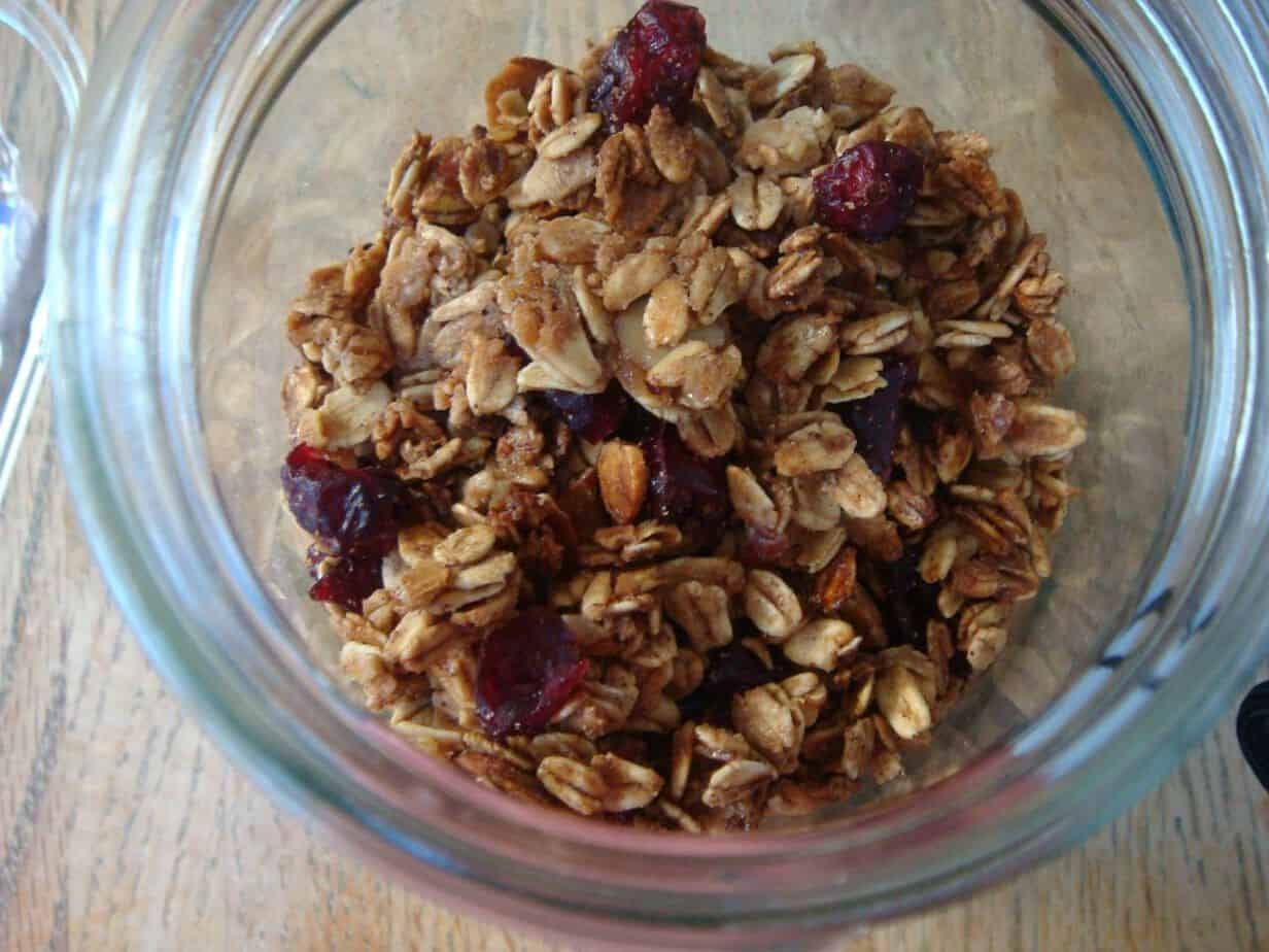 Granola with nuts and cranberries in a glass bowl