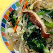 cellophane noodles, vegetables, on yellow platter