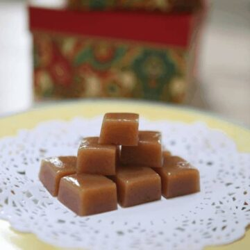 stacked caramels on lace doily on yellow plate