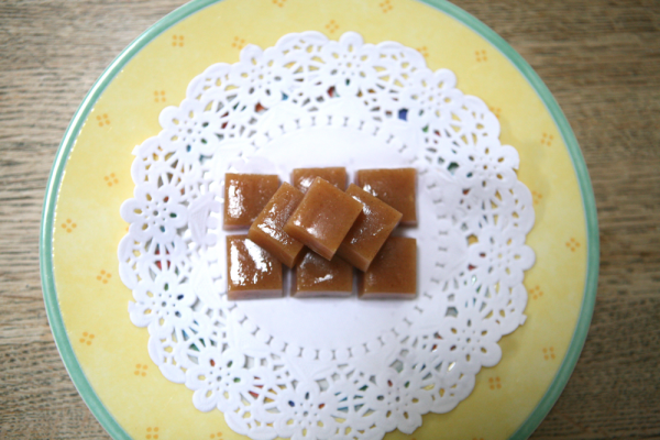 caramels on white paper doily on yellow plate