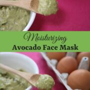 Avocado face mask on a wooden spoon over a whilte bowl on a pink placemat and eggs in the background