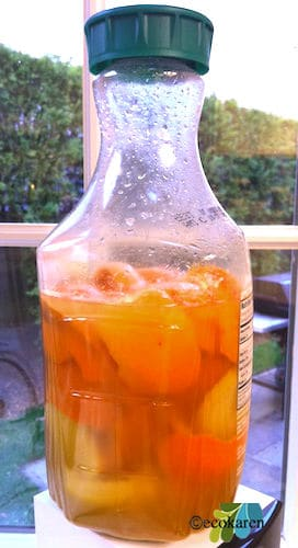 citrus enzyme cleaner in cleaned orange juice bottle