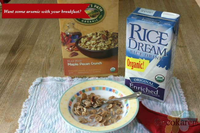 Nature's Path Cereal box next to rice milk behind yellow bowl of cereal and rice milk