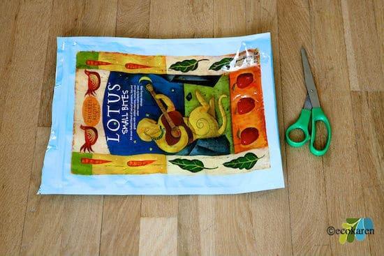 empty dog food bag next to green scissors