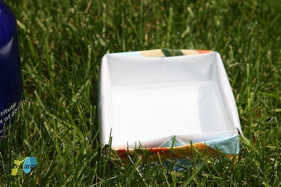 dogbowl next water bottle on grass