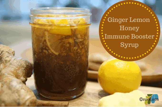 Ginger Lemon Honey Syrup in mason jar between ginger and lemon