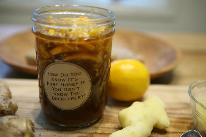 Honey lemon ginger immune booster syrup mason jar with sticker 'how do you know it's pure honey if you don't know the beekeeper?'