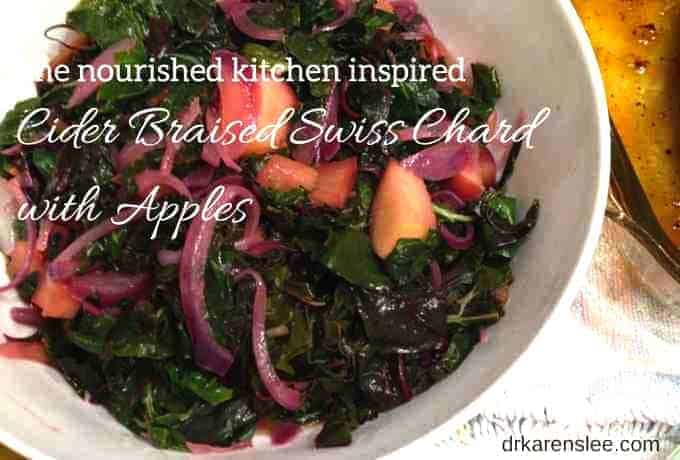 cider braised swiss chard with apples in white bowl