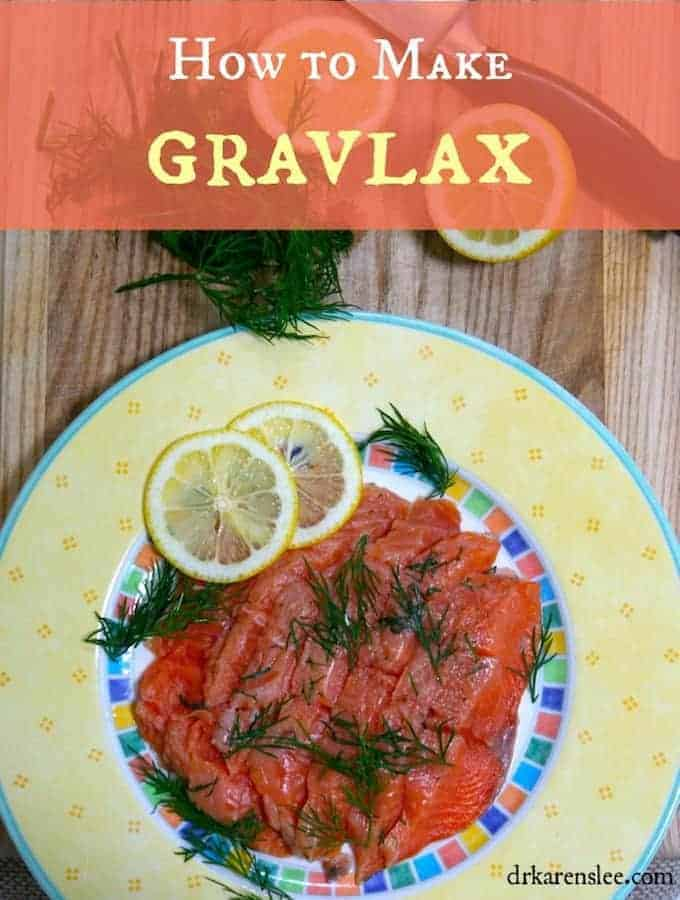 gravlax on a yellow plate with lemon slices