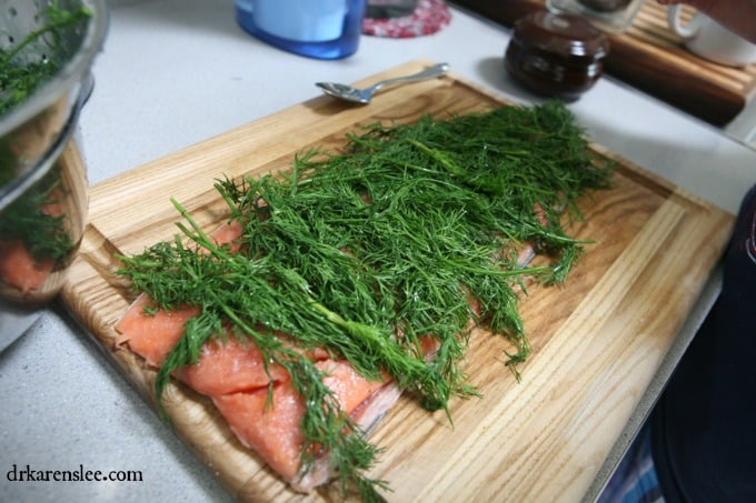 Salmon Gravlax on wood cutting board about to cure