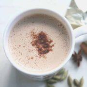 Beige colored buttered drink in white mug