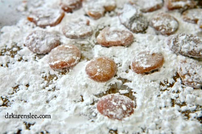 honey cough drops laying in powder sugar