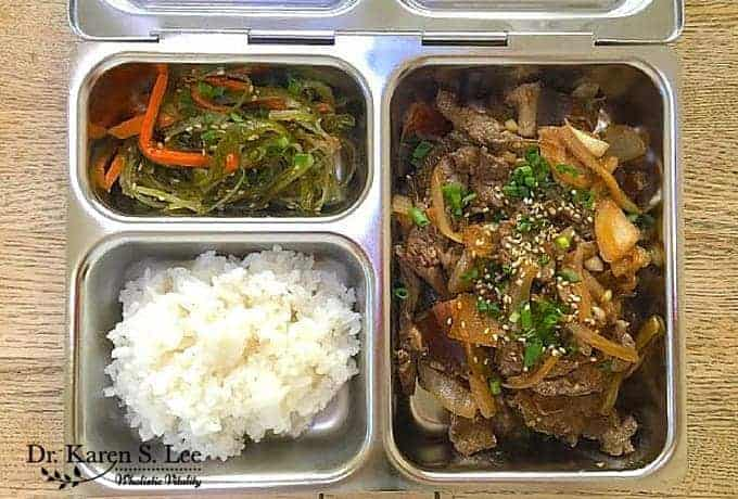 stainless steel bento style lunch box: rice, seaweed salad, and bulgogi