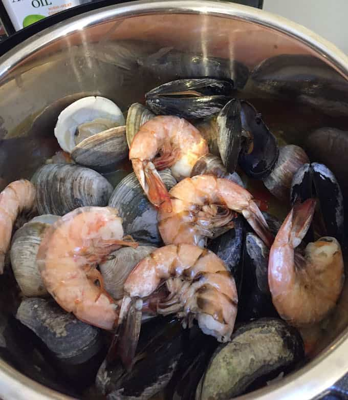 Shrimp, clams, mussels added to seafood paella