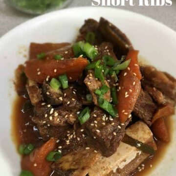 Kalbijjim Simmered Korean Short Ribs with carrots in a white bowl