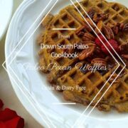 waffle on a white place with berries and pecans on top