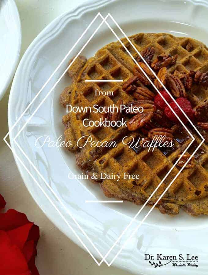 paleo waffle on a white place with berries and pecans on top