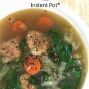 meatballs, carrots, green vegetable soup in white bowl