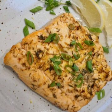 Toasted Coconut Salmon with chopped scallions on top