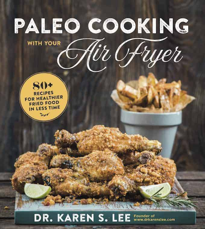 Paleo Cooking with your Air Fryer cookbook cover with fried chicken and fries on a wooden board