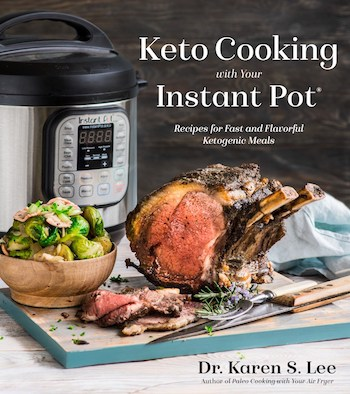 Prime Rib Roast with Brussels Sprouts on a wooden board with Instant Pot in the background on the cover of KetoCooking with your Instant Pot cookbook