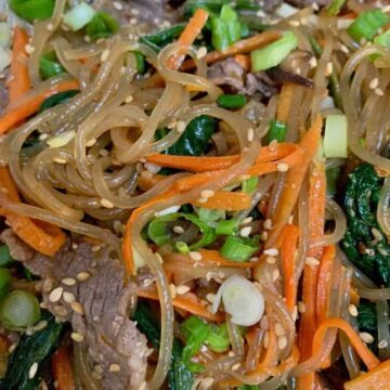 sweet potato noodles with carrots, beef, sesame seeds