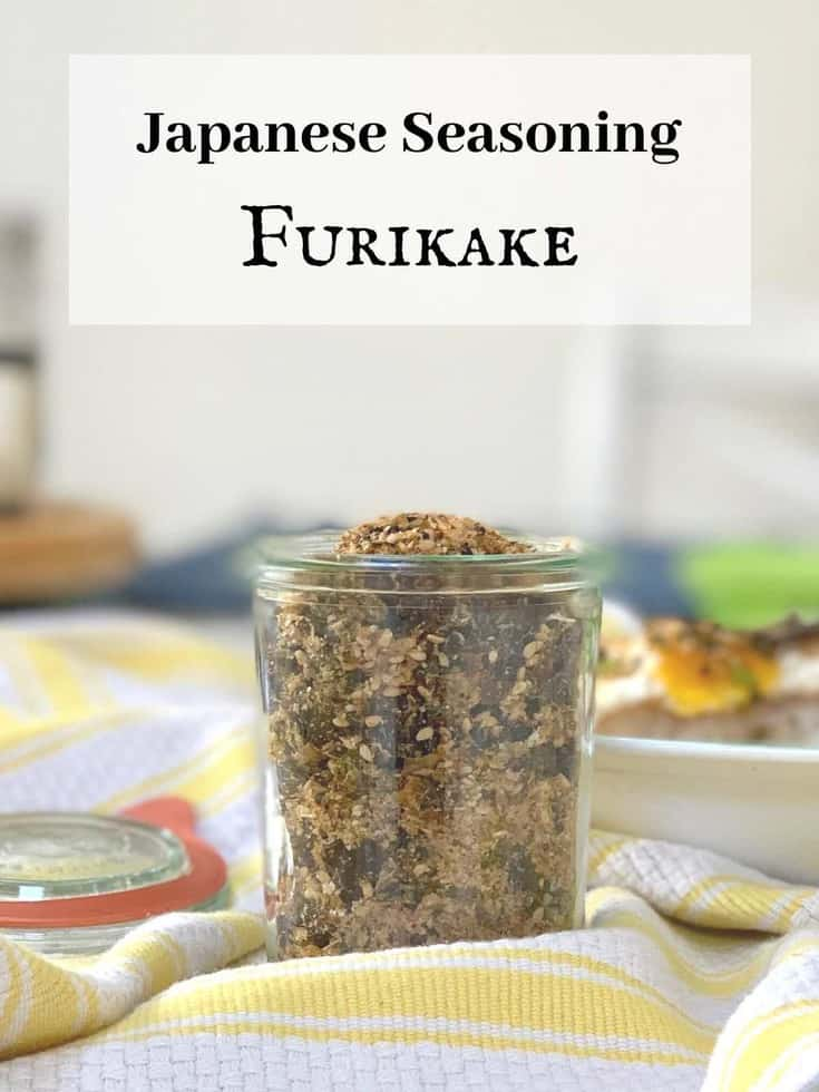 Japanese seasoning furikake with nori in a glass jar on yellow and white kitchen towel