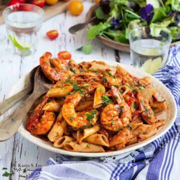 Shrimp Penne in red sauce in a while pasta bowl