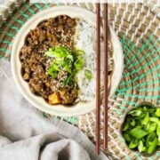Ground Beef Bowl with white rice with chopsticks resting on top