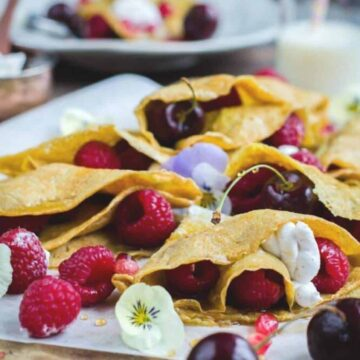 yellow egg pancakes with berries
