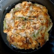 Browned seafood pancake on a cast iron pan