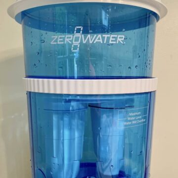 Blue and white Zero Water filtration containers on a stand