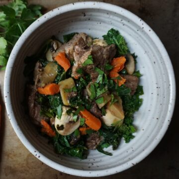 beef and vegetables in a grey bowl